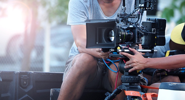 Two People Working a Camera for Production - Alpine Marketing